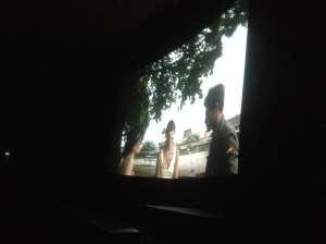 Alex Chevasco, Hannah Croft and Kristina Gren on the screen of the Cinemateket's Victor theatre in En Attendant Godard.