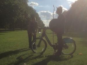 Dennis and Hadrian Gutt stand in silhouette in Hyde Park.